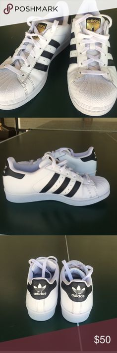 Adidas Superstar Sneakers (women's) Size 6 classic adidas superstars black and white. They run large-these will comfortably fit size 7 feet. Only worn a couple of times. In great condition. Adidas Shoes Sneakers