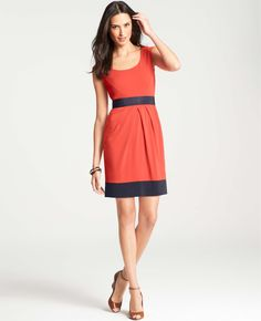 Go for a colorblocked sheath that's bright but not loud.