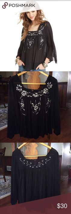 Free People Embroidered Peasant Top Worn only one time! (I just don't look good in black)  3/4 length sleeves. Rayon/Polyester blend. Machine wash. Black background with shades of grey embroidery. Super cute on!! Free People Tops