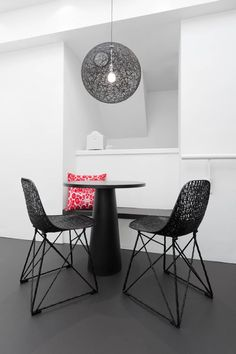 Carbon Chairs with Container Table and Random Light.