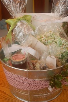 Handmade Christmas Ideas- this basket included Spiced Plum Butter  Cinnamon Anise Jelly  Handmade Recipe Cards  Chocolate Snowmen made by the kids  Gooey Popcorn  Nutmeg Cookies  and  Saltine Caramel Brittle