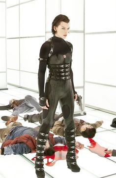 """Alice, an Umbrella Corporation hallway, and recently re-deceased zombies in """"RE: Retribution"""", the most deranged of Paul W. Anderson's """"RE"""" movies. Milla Jovovich, Resident Evil 5, Leather Catsuit, Apocalyptic Fashion, Badass Women, Cosplay Outfits, Punk Fashion, Look, Actresses"""