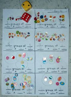 Here's a great idea for learning about the grouping model of multiplication. Roll two die. One die determines how many in a set, the other determines the number of sets. Use stickers to make it visual and then write multiplication sentences!