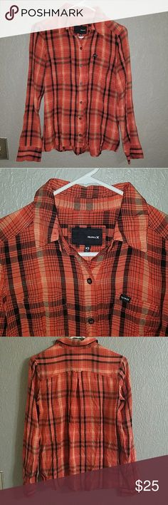 Hurley button down in EUC XS Black and orange Hurley button down top  No rips or stains😊 it's in excellent used condition! Hurley Tops Button Down Shirts
