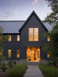 Black house, metal roof. #architecture