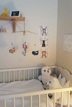 Baby corner. We don't have an extra room to make a own nursery for the baby, he will sleep in our room. But I've enjoyed even decorating the little corner with the bed with different DIY-projects.  Forest animals, whales.