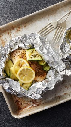 Lemon Chicken and Zucchini Foil Packs Recipe - These quick and easy lemon chicken foil packs paired with zucchini, squash and thyme are a perfect summertime dinner.