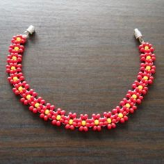 How to make a beaded floral bracelet via @Guidecentral - Visit www.guidecentr.al for more #DIY #tutorials