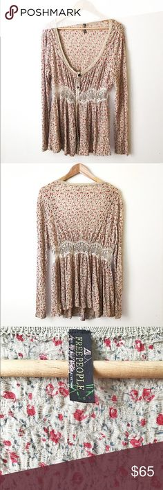 🎈sale 1 day  !🎈Free People long sleeve blouse Long sleeve floral blouse with snap buttons . Waist has a slight see through lace . Low neck . Gorgeous blouse . Free People Tops Blouses