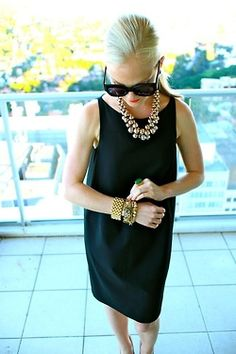 Black shift dress with bold gold accessories. Love.  And throw on a cardigan for early fall days
