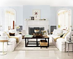 I love the ornament/bowl on the coffee table. Top Designers Share Their Favorite Gray Paint Colors via @MyDomaine