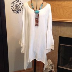 """RETAIl-WHITE BLOUSE-SIZE SMALL BEAUTIFUL WHITE BLOUSE-100% RAYLON-LACE SLEEVES-CROSS STRAPS IN THE BACK-PULL OVER-FROM ARMHOLE TO ARMHOLE IS ABOUT 20""""-LENGTH IS ABOUT 30 1/2""""-AT THE SHORT PART DOWN THE MIDDLE NOT THE POINT Entro Tops Blouses"""