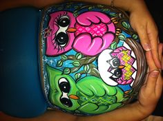 An owl belly painting I did for a friend who's having a baby girl. Their colors were pink an green in the nursery.