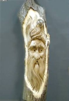 wood spirits carvings | ... wood spirit face was carved in a butternut log. The grain of the wood