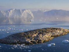 Small Rocky Island and Icebergs