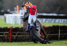 Paddy Brennan and Pitter Patter fall whilst leading at the last in The Super Sunday 8th February Mares' Handicap Hurdle Race at Exeter Racecourse on January 19, 2015 in Exeter, England. (January 18, 2015 - Source: Dan Mullan/Getty Images Europe)
