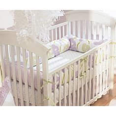 This is my baby girls nursery bedding with a white crib.  I wanted to do lilac and sage as the color scheme and I loved this