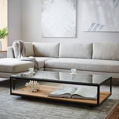 Black leather tufted couch, light toned and brass arm chairs and this coffee table.