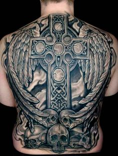 Superb complete back tattoo featuring a Celtic cross and a pair of wings that spring out of it raising above skulls.