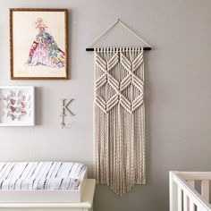 This Macrame Wall Hanging is made with 100% cotton rope. It measures 16 inches at its widest point, is 45 inches long and is hanging on a 20 inch Black Metal rod. This hanging is perfect for any room. It is great for a bedroom, living area, workspace or anywhere where youd like to bring some texture and interest to your walls. If you would like a custom order, or a few pieces of the same vibe, please dont hesitate to contact me. Designed and Crafted in California ***This is a custom order...