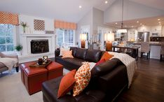 Property Brothers Episode 409| brown sofa, greige walls, pops of orange, open concept