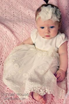 Cute baby blessing dress, adorable little girl. Love her eyes. I like this idea of a shorter dress, it would be useable on a regular Sunday as well as blessing day. The long ones are gorgeous though. Baptism Outfit, Christening Outfit, Baptism Dress, Christening Gowns, Baptism Clothes, Christening Headband, Baby Blessing Dress, Baby Dress, Vintage Inspiriert