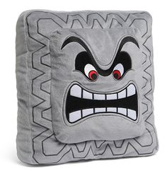 Thwomp pillow ---- I would throw this at people. This would be my official whacking pillow. :)