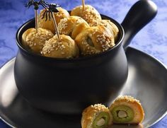 Garlic scares away Dracula, but not guests. Wrap refrigerated flaky dough around garlic-stuffed olives.