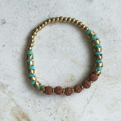 Nirvana's Maharani Shakti Bracelets are precious handcrafted jewelry that feature crown-shaped brass pieces, interspersed with beautiful beads of colored glass and sacred Rudraksha seeds from our beloved India.