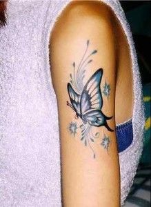 butterfly tattoo- love this but in red and  with my daughters name :)