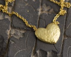 Dainty silver gold filled heart necklace.  https://www.etsy.com/listing/224055550/dainty-gold-filled-heart-necklace