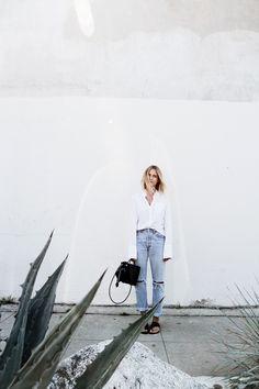 White shirt, pale denim boyfriend jeans & ATP sandals on Mija Flatau | @styleminimalism