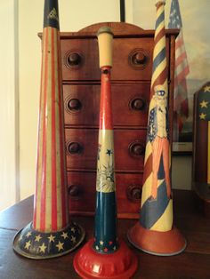 old red, white and blue tin horns....love...