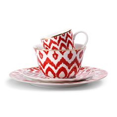 What a way to brighten up the table.  Coral Ikat Dinnerware - Tabletop - Shop by Category - Home & Decor