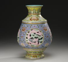 (Qing) Famille Rose. A rare Famille Rose reticulated revolving Vase. Qianlong seal mark & period. ca 18th century CE. China.
