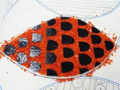 Preparing one of the fused fish for a primary school door panel.