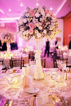 Tall wedding centerpieces. Photography by www.thebrotherswright.com/bwrightphoto/