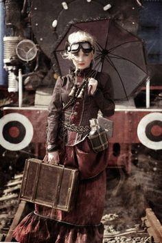 Gypsy Diesel Steam Traveler - victorian steampunk costume includes blouse, skirt, goggles, binoculars, canteen, umbrella/parasol and and valise.