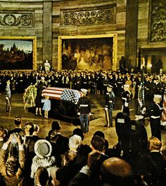 11/24/63: Jacqueline and Caroline Kennedy kneel to kiss JFK's coffin, in the Capitol Rotunda.