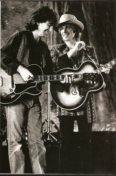 George Harrison and Tom Petty.