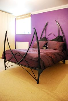 Demon iron bed with the low foot frame option, the standard clawed feet were not required. www.spwironworks.co.uk