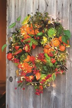 Sarah Raven gives detailed instructions on how to put together a foraged Christmas wreath from your garden.