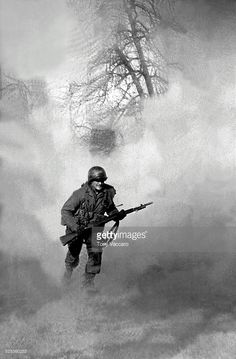 American GI Ivan Parrott is seen running through smoke in no mans land near Neuss, Germany during the Battle for the Rhine, World War II, 1st March 1945.