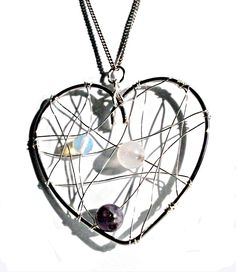 £8.75 Silver Wire Wrapped Heart with Amethyst Rose Quartz and by Onuava