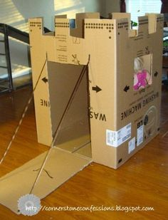 Turn an old cardboard box into a castle. Your kids will love making this! | Recycle that Container