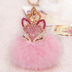 Rhinestone cute fox design fur ball plush key-chain Item Type: Key Chains Fine or Fashion: Fashion Style: Trendy Material: Pearl Metals Type: Zinc Alloy Pearl Type: Simulated-pearl Shape\pattern: Anim