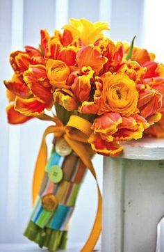 "Fun ""Retro"" Feel To This Wedding Bouquet Which Showcases: Orange Ranunculus, Orange Parrot Tulips & Yellow Freesia>>>>"