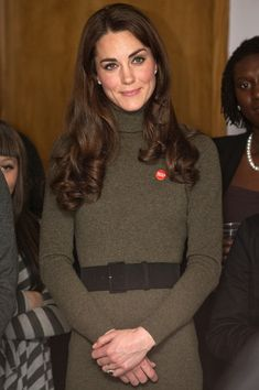 Catherine, Duchess of Cambridge watches a performance during a visit to Centrepoints Camberwell Foyer on December 21, 2011 in London, England. The national charity, Centrepoint, provides housing and support to improve the lives of homeless young people aged 16-25.