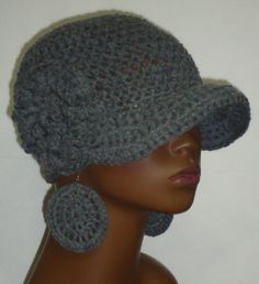 Rock this cap/earrings set only where being fabulous is allowed. It's a stunna. Cap is made with acrylic yarn and will stretch to the size of your head Earrings are approx 2.5 inches in diameter and super light weight Please note that photos are of a mannequin. Actual fit will vary depending on your head size.