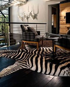 Zebra rugs are becoming a new trend in a lot of interior design projects featured in living rooms, foyers and lounge spaces. Have a look at this beauty. Zebra Skin Rug, Trophy Rooms, Ottoman, This Is Us, Lounge, Design Inspiration, Interior Design, Rugs, Entrance Hall
